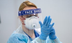A member of staff receives training on how to put on and remove PPE at the Nightingale Hospital North West in Manchester.