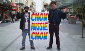 Jake Holmes and Peter Drew with their C'mon Aussie poster on Adelaide's Rundle Mall.