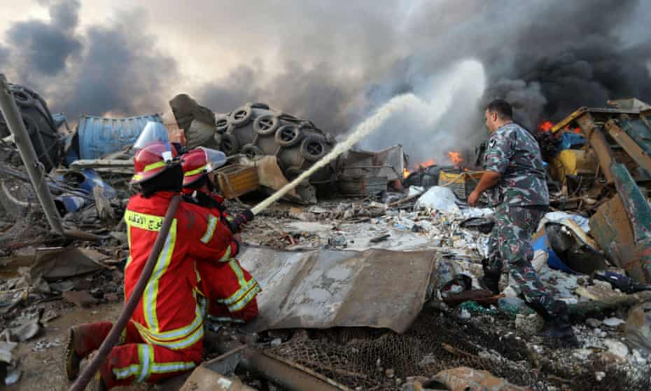 Firefighters tackle a blaze following an explosion in Beirut's port area