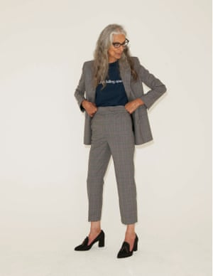 grey checked jacket and trousers, Zara, dark blue T-shirt with slogan in white, Blouse, Matches Fashion, black high heeled loafers Russell and Bromley & Stuart Weitzman, black framed glasses Tom Davies