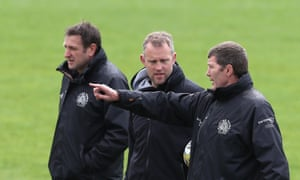 Exeter Chiefs head coach, Rob Baxter, talks to his assistant coaches Rob Hunter and Ali Hepher during training