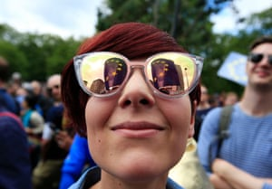 A remain supporter on Park Lane with the European Union flag reflected in her sunglasses