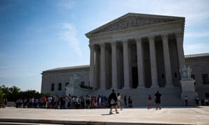 People gather in front of the supreme court in Washington on Monday as the court sidestepped two major cases concerning partisan gerrymandering.