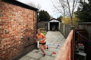 Cloda Lowden runs a marathon in her garden in Manchester