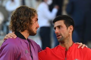 Novak Djokovic (right) consoles Stefanos Tsitsipas.