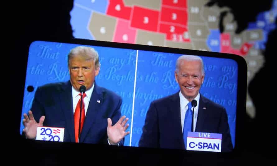 The final presidential debate between Donald Trump and Joe Biden on a smartphone screen, 23 October 2020.
