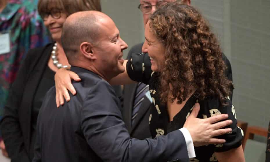 Josh Frydenberg kisses his wife Amie after delivering the 2019 federal budget.