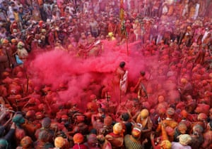 Explosion of red powder in crowd