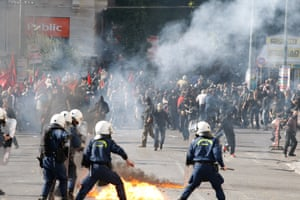General Strike in Greece<br>12 Nov 2015, Athens, Attica, Greece --- Nov. 12, 2015 - Athens, Greece - A riot policeman tries to avoid a petrol bomb thrown by protesters during a rally in Athens. Nearly 25,000 people had been participating in three separate demonstrations in central Athens, according to police figures, protesting a new round of bailout-related tax hikes and spending cuts. (Credit Image: © Aristidis Vafeiadakis via ZUMA Wire) --- Image by © Aristidis Vafeiadakis/ZUMA Press/Corbis