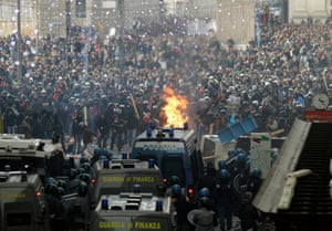 2010: demonstrators clash with police in Rome's Piazza del Popolo after Berlusconi won back-to-back votes of confidence in the Italian parliament
