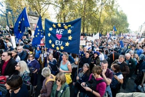 Crowds carry 'We ❤️ EU' signs.