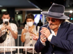 San Sebastián, Spain: Actor Johnny Depp lights up a cigar upon arriving to the premiere of his film Crock of Gold: A few Rounds with Shane MacGowan, as part of 68th San Sebastián international film festival