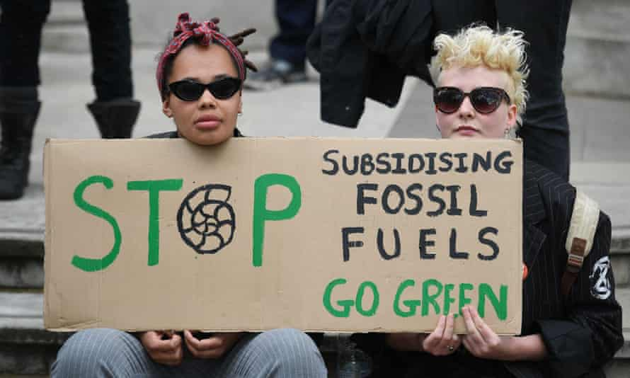 Extinction Rebellion protesters stage a sit-down outside the Treasury in central London last week.
