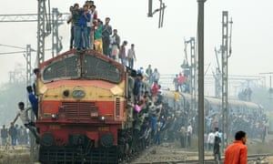 A train departing a station on the outskirts of Delhi