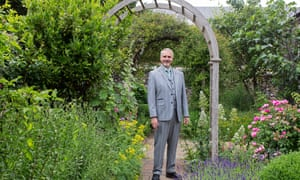 Nigel Utton in garden of Norwich cathedral