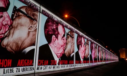 The mural painting 'My God, Help Me to Survive This Deadly Love' by Russian painter Dmitri Vrubel is projected on a stretch of the Berlin Wall at the East Side Gallery.