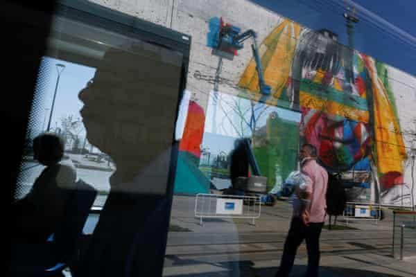 Reflections of a mural on Rio's Olympic Boulevard