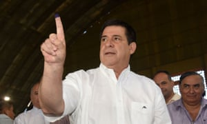 Paraguay's president Horacio Cartes shows his inked finger after voting in the presidential election in April. Cartes will be replaced in the next few weeks by Mario Abdo Benitez.