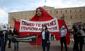 Art workers demonstrate outside the Greek parliament building in Athens.