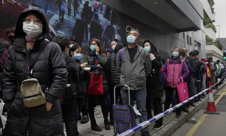 Citizens line up to buy face masks