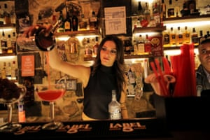 Dana, 24, a bartender, pours a drink inside a bar in the Old City . 'During the war, when bombs were falling, it could be days without customers, but we never stopped working,' she says.