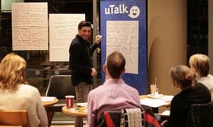 Alessandro Fantauzzo teaches students in coffee shop