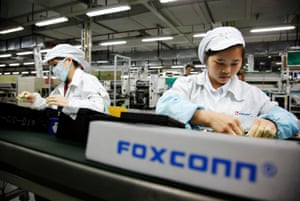 The Foxconn factory in Shenzhen. Workers have accused developers of forcing them from their homes.
