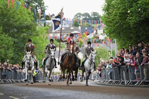 Selkirk, Scotland. Standard bearer Kieran Riddell and his attendants ride through the town as part of the Common Riding, one of the oldest Borders festivals dating from the Battle of Flodden in 1513