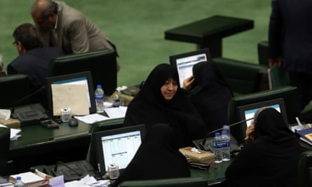 Iranian lawmakers take part during a parliament session in Tehran, Iran, on Tuesday at which they passed a bill labeling US forces in Middle East as terrorist.