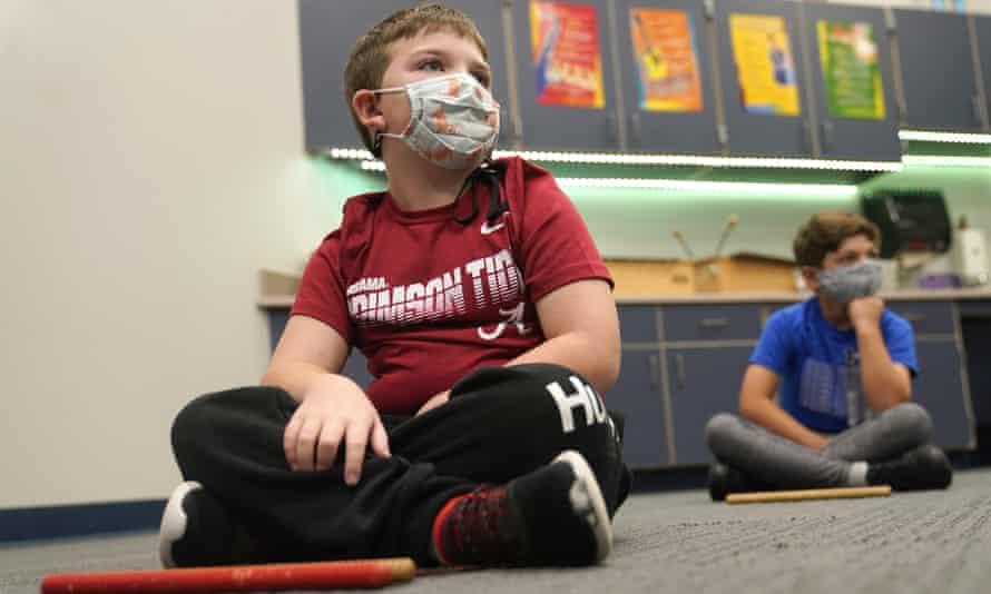 Third graders listen during a music class in Murphy, Texas, in December 2020.