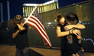People embrace on the first anniversary of the mass shooting in Las Vegas, on 1 October 2018.