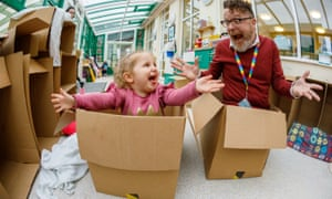 Head teacher Matt Caldwell at Ilminster Avenue Nursery School in Bristol and toddler in cardboard boxes