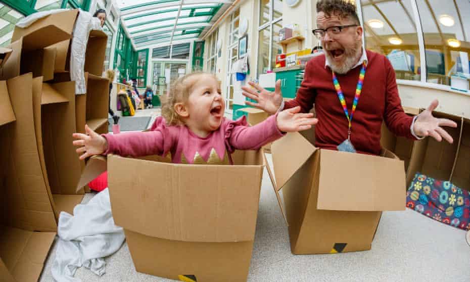 Head teacher Matt Caldwell at Ilminster Avenue Nursery School in Bristol and toddler in cardboard boxes