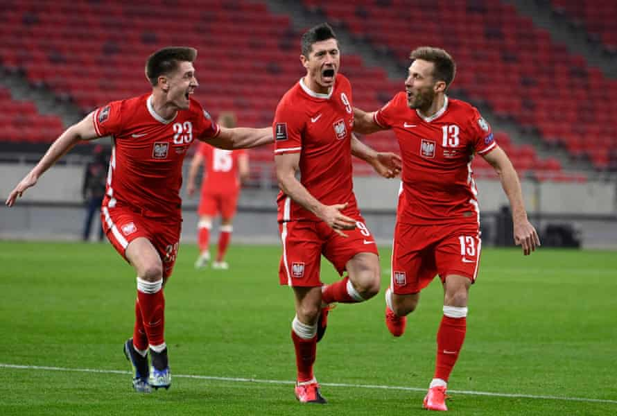 Robert Lewandowski is chased by his Poland teammates after his fine late equaliser in Budapest.