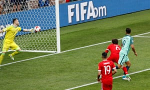 Russia's Igor Akinfeev saves from Portugal's Andre Silva.