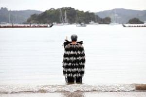 Kuia waits for waka to arrive outside Te Tiriti o Waitangi marae on February 06, 2020.