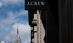 A J Crew sign outside a branch of the fashion retailer on 5th Avenue in New York.