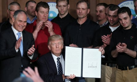 Donald Trump, with Scott Pruitt and a group of miners, after signing an executive order on 'energy independence' in Washington.