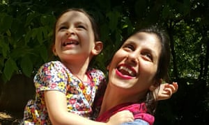 Nazanin Zaghari-Ratcliffe (R) embraces her daughter Gabriella.