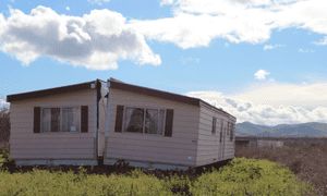 A manufactured home split in two on the edge of town in Patterson, California.