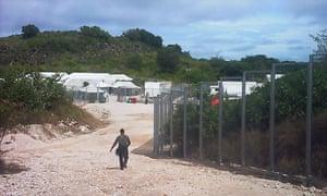 A guard outside the Australian-run migrant detention centre in Nauru.