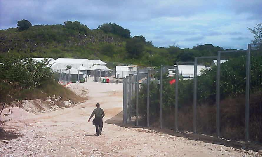 A guard walks towards the entrance of the Nauru detention centre. This photo was one of number of images received by Guardian Australia in May 2015, depicting life and conditions for asylum seekers on Nauru. Photo supplied by an unnamed source. Background info supplied by the picture editor: Nauru is an island in the South Pacific which has detention centres for asylum seekers, run by Australia's immigration services. Some asylum seekers are granted asylum (refugee status) to live on the island in open camps.