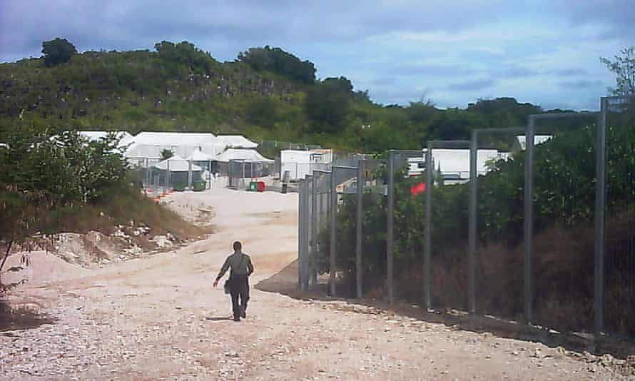 A guard walks towards the entrance of the Nauru detention centre in May 2015.