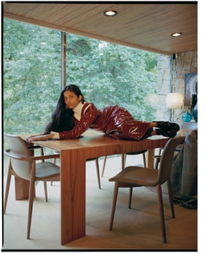 Latex and PVC dress, £1,495, top, £660, coat (on chair), £2,450, and boots, £685, all by Ellery. Earring, £350, by Alighieri.
