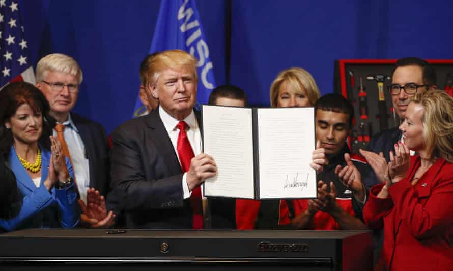 "Donald J Trump signs the ""Buy American, Hire American"" executive order in Wisconsin."