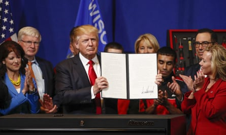 """Donald J Trump signs the """"Buy American, Hire American"""" executive order in Wisconsin."""