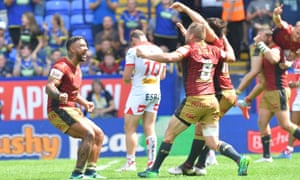 Catalans Dragons players celebrate at the final whistle after the Challenge Cup semi-final in Bolton.