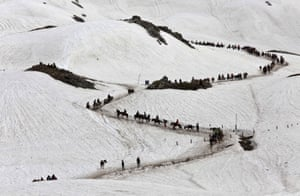 Waval, Indian Kashmir Hindu pilgrims cross a snow-covered mountain to reach the Amarnath cave shrine, where they will worship an ice stalagmite as the symbol of Lord Shiva