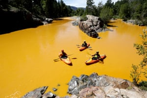 People kayak in the Animas River near Durango turned yellow through mine waste