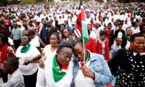 Kenyans pray during a rally in Nairobi calling for peace before the election.